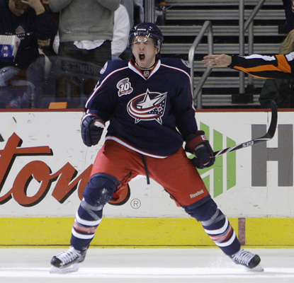 The Blue Jackets' Kyle Wilson celebrates after scoring his first NHL goal in a game against the Flyers.  (AP)