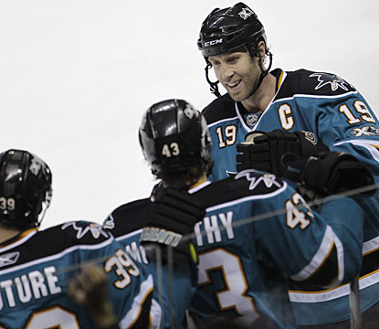 Joe Thornton (19) gets congratulations from teammates after completing his fourth career three-goal game. (AP)