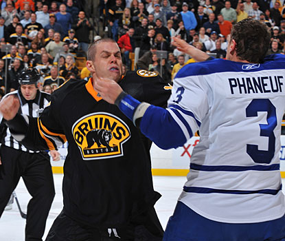 In addition to Tim Thomas' 20-save clean sheet, Nathan Horton and Dion Phaneuf slug it out in the second period. (Getty Images)