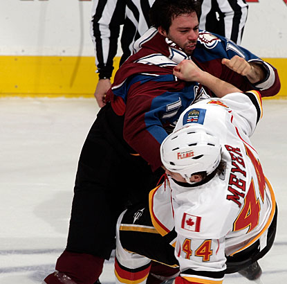 Colorado's Philippe Dupuis takes down Calgary's Stefan Meyer after trading some heavy punches. (Getty Images)