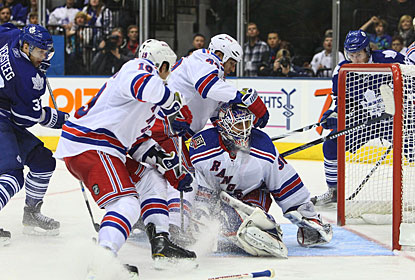 Henrik Lundqvist withstands some pressure, gets good help from his defensemen and blanks the Maple Leafs. (US Presswire)