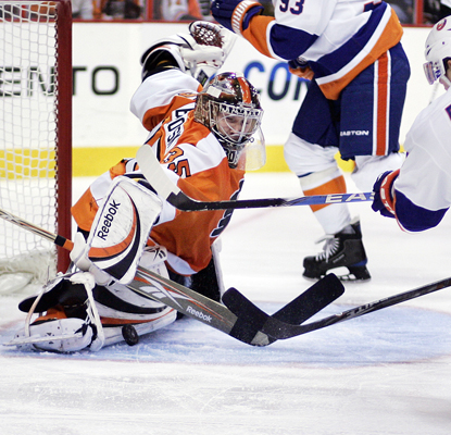 The Flyers' goalie Sergei Bobrovsky makes a pad save -- one of 30 on the night -- on a shot by the Islanders' Josh Bailey. (Getty Images)