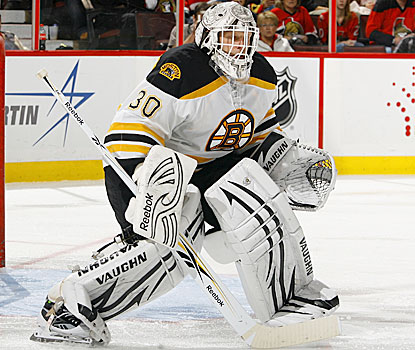 Tim Thomas collects his fifth shutout against the Senators and rounds to 20 shutouts for his career. (Getty Images)