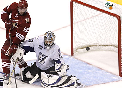 While it looks like the puck is going in, Dan Ellis deflects the shot to preserve his first shutout since Jan. 15. (AP)
