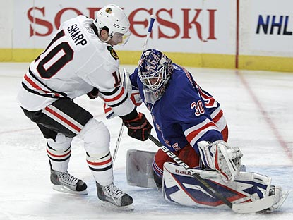 Patrick Sharp is denied in the first period, one of 33 saves Henrik Lundqvist makes for the Rangers.  (AP)