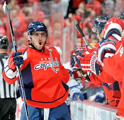 Alex Ovechkin meets the receiving line on the bench on a night when he scores in the shootout.  (Getty Images)