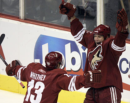 It takes him 15 years in the NHL, but Ed Jovanovski finally gets to celebrate his first career hat trick. (AP)