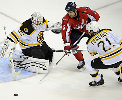 Tim Thomas gives up more than two goals for the first time this season, but is not credited with the loss. (AP)