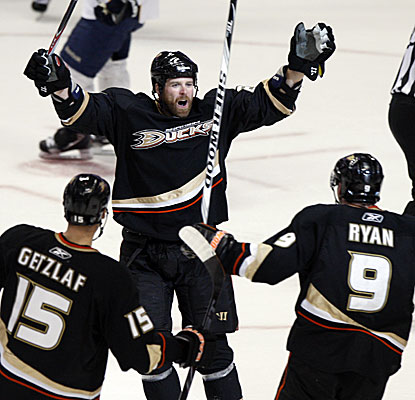 Ducks Ryan Getzlaf and Bobby Ryan celebrate after Paul Mara, center, scores the game-winner against the Predators. (AP)