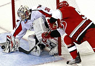 Rookie Michal Neuvirth has been a huge net plus. (AP)