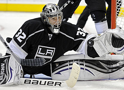 Kings goalie Jonathan Quick makes one of his 27 saves against the Dallas Stars. (AP)