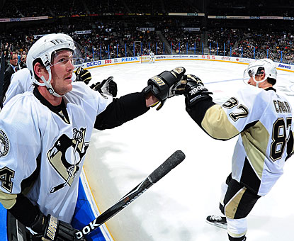 Sidney Crosby (87) gets congratulations from Matt Cooke for scoring his 12th goal of the season. (Getty Images)
