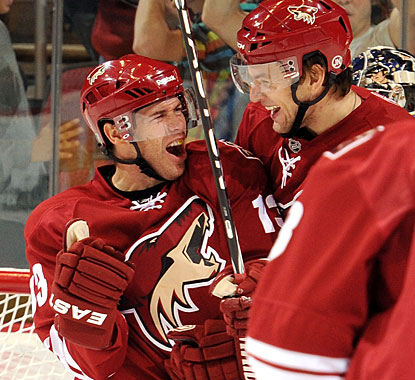 Ray Whitney (left) enjoys his hat trick with Martin Hanzal, who also scores a goal on the night. (Getty Images)
