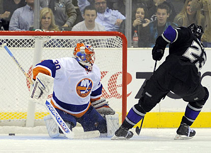 Dustin Brown scores the Kings' fourth goal when he converts a penalty shot in the third period. (AP)