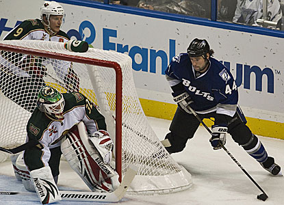 Minnesota Wild goalie Niklas Backstrom covers the net as Tampa Bay's Nate Thompson threatens to score. (AP)