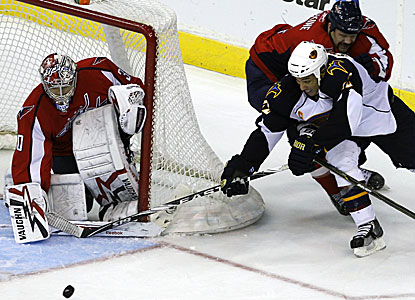 John Erskine, top right, holds Thrashers right wing Anthony Stewart off the puck and scores the tie-breaking goal for the Caps. (AP)