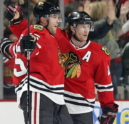 Viktor Stalberg (left) is met first by Duncan Keith after he nets the winner with just 28 seconds left in overtime.  (Getty Images)