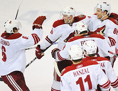 After tying the game with 35 seconds left in regulation, the Coyotes continue the celebration after the shootout. (AP)