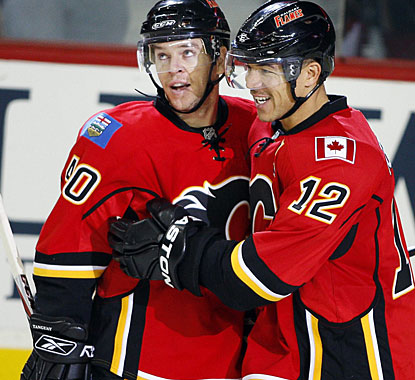 Jarome Iginla (12) enjoys his hat trick with Alex Tanguay, who assists on three goals in the game. (AP)