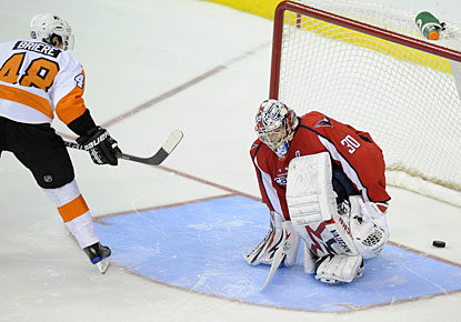 Of all the attempts in the shootout, Danny Briere is the only one who manages to put the puck in the back of the net. (AP)