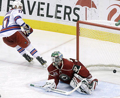 Brandon Dubinsky beats Niklas Backstrom in the third period, scoring for only the second time in eight games. (AP)