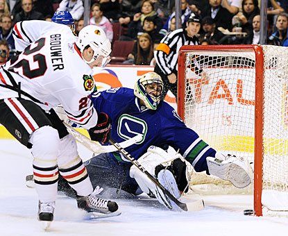 Troy Brouwer squeezes the puck past Roberto Luongo for the second of four Chicago goals in the second period. (Getty Images)
