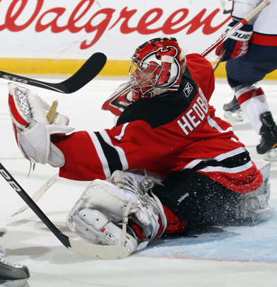 The Devils' Johan Hedberg nabs his 15th career shutout by saving 30 against the NHL-leading Capitals.  (AP)