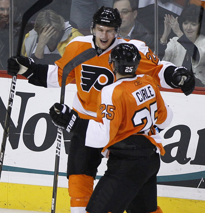 The Flyers' James van Riemsdyk (left) and Matt Carle celebrate after van Riemsdyk's goal in the third. (AP)