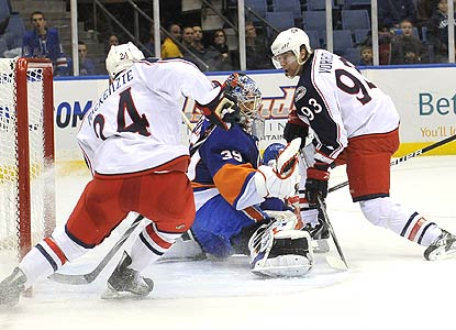 Jakub Voracek gets the puck past Islanders goalie Rick DiPietro for the winning goal in overtime. (AP)