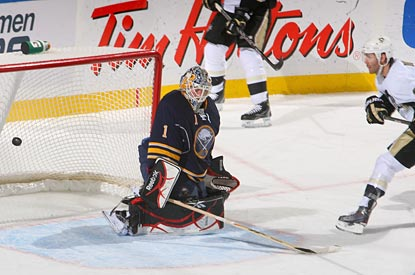 Pascal Dupuis (right) gets the puck past Jhonas Enroth late in the first period for the game's only goal.  (Getty Images)