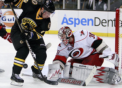 Cam Ward turns away all 37 shots -- including this one by Brad Marchand -- for his first shutout of the season. (AP)