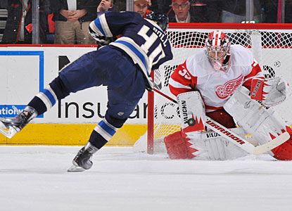 Jared Boll can't find a way to beat Jimmy Howard on this penalty shot in the second period. (Getty Images)