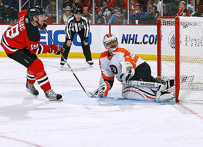 Travis Zajac beats Flyers goalie Brian Boucher for the game winner in the fourth round of the shootout. (Getty Images)