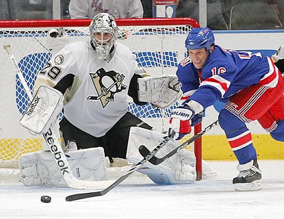 Despite Sean Avery's efforts here, Marc-Andre Fleury shuts out the Rangers in the third period to secure Pittsburgh's victory.  (AP)