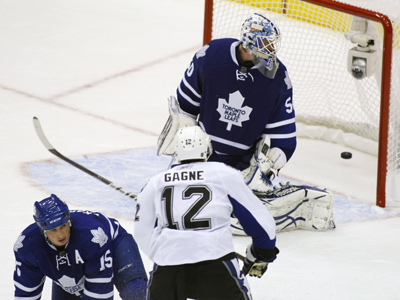 The Lightning's LW Simon Gagne scores the winning goal in OT against Jonas Gustavsson. (US Presswire)