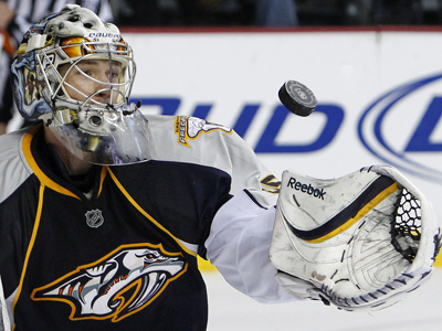 Pekka Rinne shows flashes of brilliance while saving 33 to blank the Coyotes.  (AP)