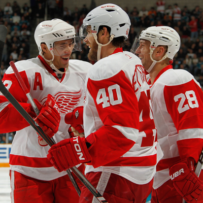 Henrik Zetterberg (40) celebrates with teammates after scoring his second goal on the night.  (Getty Images)