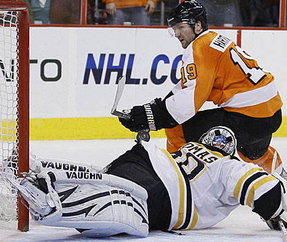 Tim Thomas gets enough of the puck to deny Scott Hartnell on this penalty shot. Thomas leads the NHL with five shutouts. (AP)
