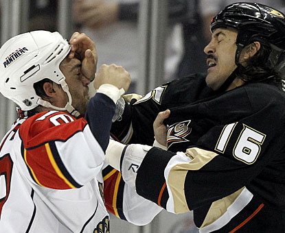 Not only does George Parros (right) score two goals, but he also does what he does best ... fight, with Darcy Hordichuk. (AP)