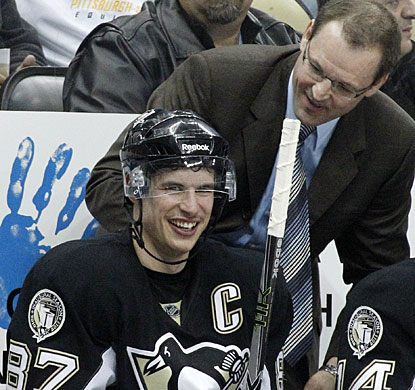 It's smiles all-around for coach Dan Bylsma and his star after Sidney Crosby scores his third goal of the night. (AP)