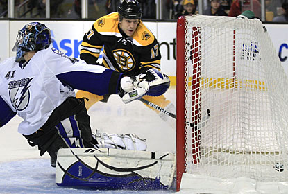 Milan Lucic makes it 3-0 with his 12th goal and the Bruins never look back in the game. (AP)