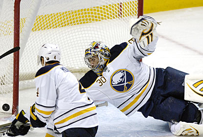 Ryan Miller makes one of his 19 saves against the Blue Jackets for his first clean sheet of the season. (AP)
