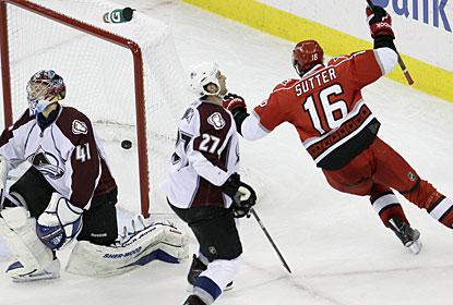 Brandon Sutter puts the puck past Craig Anderson for the winner just 75 seconds into the overtime period. (AP)