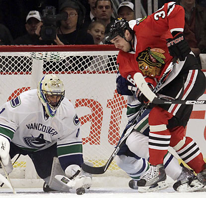 Dave Bolland has no luck knocking the puck past Roberto Luongo, who earns his second shutout of the season. (AP)