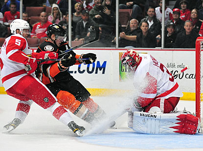Pucks, snow showers, Jimmy Howard faces it all and stops it all against the Ducks for his second shutout. (US Presswire)