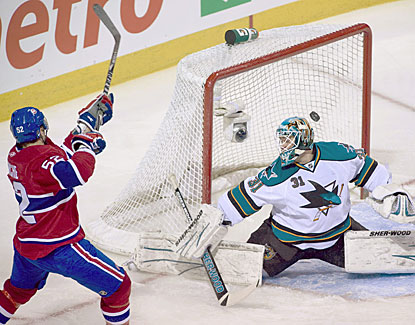 Mathieu Darch beats Antii Niemi from a bad angle at the side of the net to score for the Canadiens. (AP)