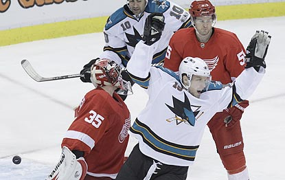 San Jose's Dany Heatley celebrates a teammate's tally during the Sharks' pivotal three-goal second period.  (AP)