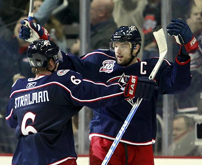 Anton Stralman (left) is the first to congratulate Rick Nash after he ties the game in the final minute of the third period.  (AP)