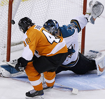 It looks like Danny Briere has a goal in the shootout, but the puck hits the post and the Sharks get the win. (AP)