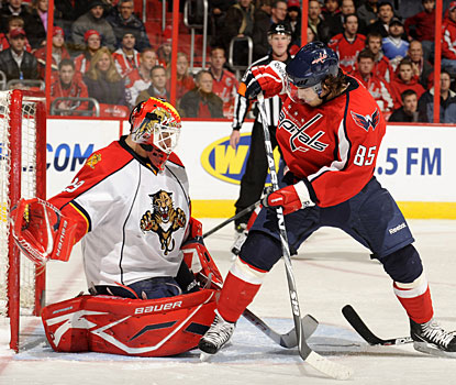 Tomas Vokoun faces all kinds of pressure, but stops 36 shots for his third shutout this season. (Getty Images)